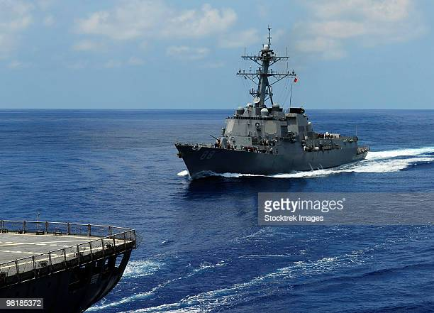 Guided-missile destroyer USS Preble approaching the Military Sealift Command oiler USNS John Ericsso