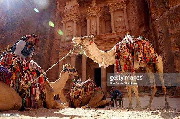 Guides and camels wait for tourists in front of the Al Khazneh The Petra Tresury on February 7 2015 in Petra Jordan After the hostage crisis by the...