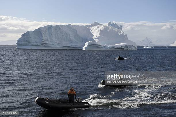 Guides wait for tourists to board thier rubber dinghies to cruise the western Antarctic peninsula on March 05 2016 The Antarctic tourism industry is...
