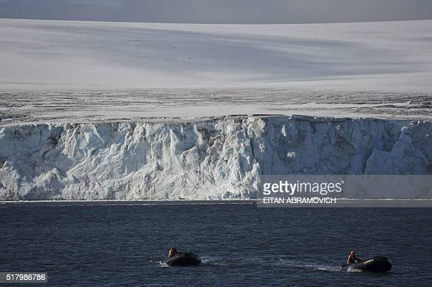 Guides wait for tourists to cruise the western Antarctic peninsula on March 06 2016 The Antarctic tourism industry is generally considered to have...