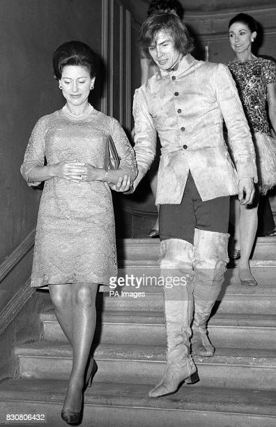 A guiding hand gallantly placed on the arm of Princess Margaret by ballet star Rudolf Nureyev as they descend the staircase at the Royal Academy of...
