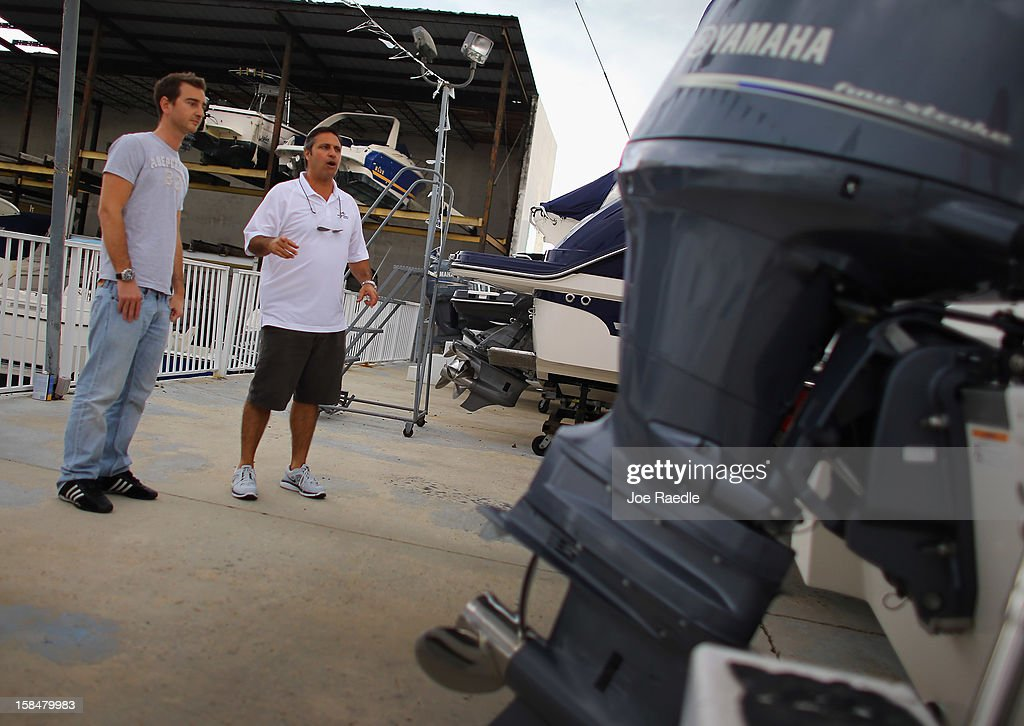 Guido Blanco (R) of Bob Hewes Boats at Arch Creek Marina helps Nicolas Gilberg shop for a powerboat on December 17, 2012 in North Miami, Florida. According to the National Marine Manufacturers Association sales of new recreational powerboats are estimated to be up by 10 percent in 2012.