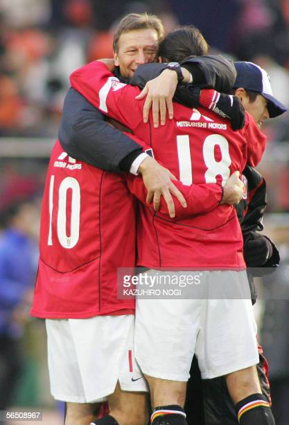 Guido Buchwald German head coach of Japanese football club Urawa Reds and players hug each other to celebrate their winning match at the Emperor's...