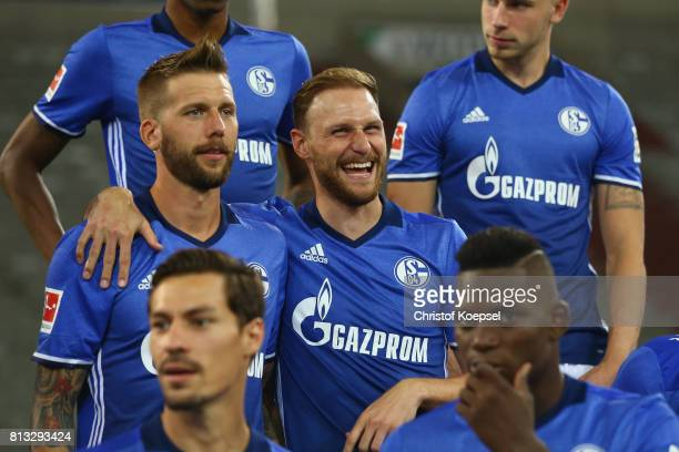 Guido Burgstaller and Benedikt Hoewedes of FC Schalke 04 pose during the team presentation at Veltins Arena on July 12 2017 in Gelsenkirchen Germany