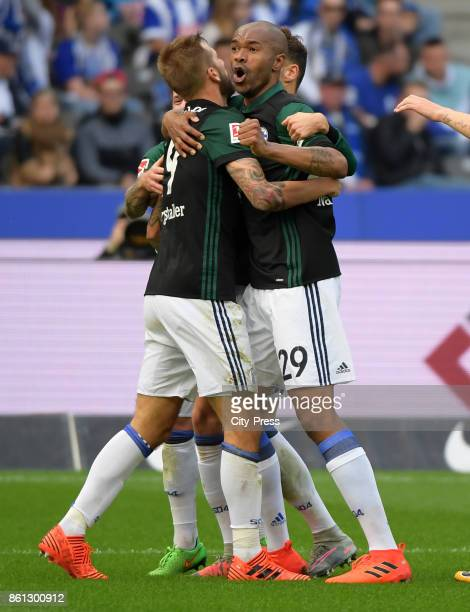 Guido Burgstaller and Naldo of FC Schalke 04 celebrate after scoring the 02 during the game between Hertha BSC and Schalke 04 on october 14 2017 in...