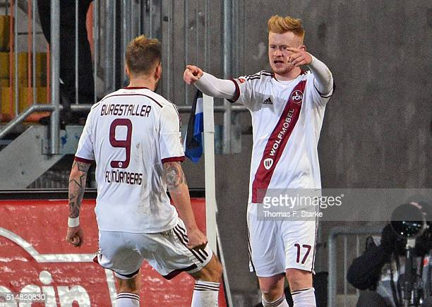 Guido Burgstaller and Sebastian Kerk of Nuernberg celebrate during the Second Bundesliga match between Arminia Bielefeld and 1 FC Nuernberg at...
