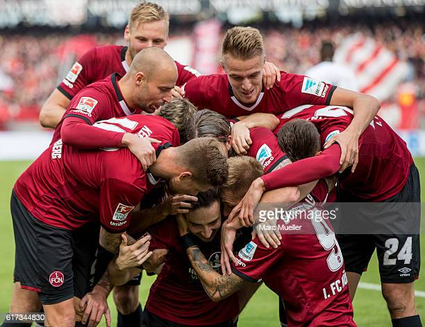 Guido Burgstaller of 1 FC Nuernberg celebrates with his team the second goal during the Second Bundesliga match between 1 FC Nuernberg and Hannover...