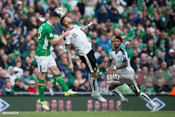 Guido Burgstaller of Austria jumps for the ball with Kevin Long of Ireland during the FIFA World Cup 2018 Qualifying Round Group D match between...