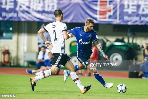 Guido Burgstaller of FC Schalke 04 and Matej Mitrovic of Besiktas comepte for the ball during the 2017 International soccer match between Schalke 04...