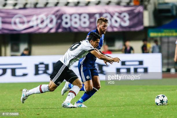 Guido Burgstaller of FC Schalke 04 and Necip Uysal of Besiktas comepte for the ball during the 2017 International soccer match between Schalke 04 and...