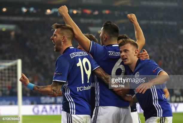 Guido Burgstaller of FC Schalke 04 celebrates as he scores their second goal with team mates during the UEFA Europa League quarter final second leg...
