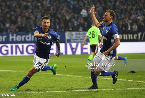 Guido Burgstaller of FC Schalke 04 celebrates as he scores their second goal with team mate Benedikt Howedes during the UEFA Europa League quarter...