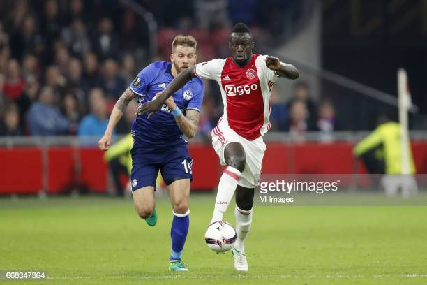 Guido Burgstaller of FC Schalke 04 Davinson Sanchez of Ajaxduring the UEFA Europa League quarter final match between Ajax Amsterdam and FC Schalke 04...