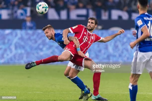 Guido Burgstaller of FC Schalke 04 Javi Martinez of FC Bayern Munich during the Bundesliga match between Schalke 04 and Bayern Munich on September 19...