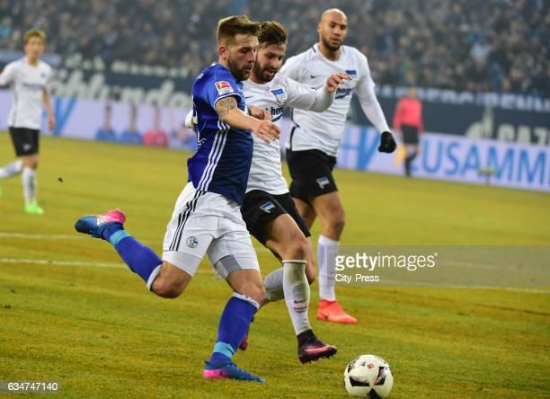 Guido Burgstaller of FC Schalke 04 scores the 10 next to Marvin Plattenhardt of Hertha BSC during the game between FC Schalke 04 and Hertha BSC on...