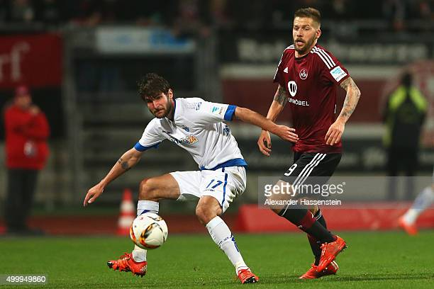 Guido Burgstaller of Nuernberg battles for the ball with Niklas Hoheneder of Paderborn during the Second Bundesliga match between 1 FC Nuernberg and...