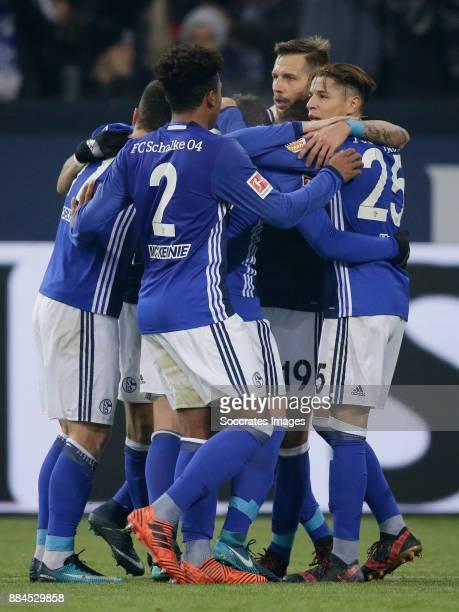 Guido Burgstaller of Schalke 04 celebrates 10 with Weston Mckennie of Schalke 04 Amine Harit of Schalke 04 during the German Bundesliga match between...