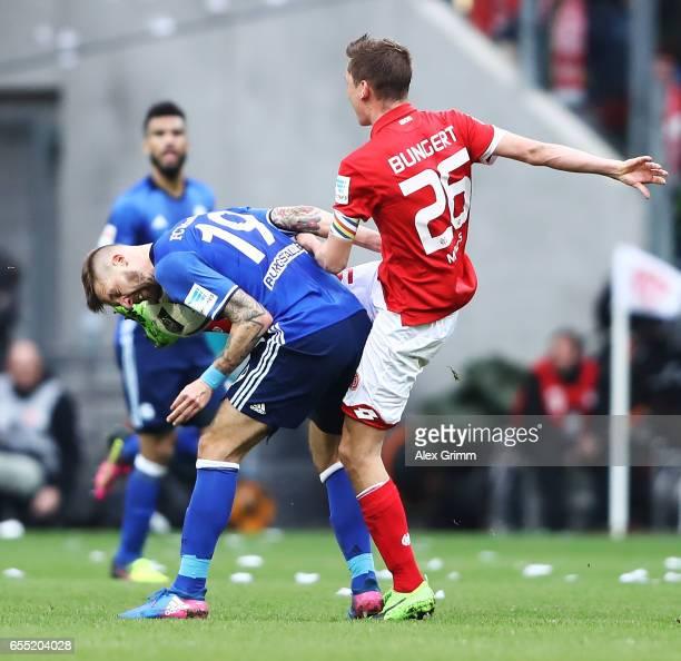 Guido Burgstaller of Schalke 04 is kicked in the head by J Gbamin of FSV Mainz 05 during the Bundesliga match between 1 FSV Mainz 05 and FC Schalke...