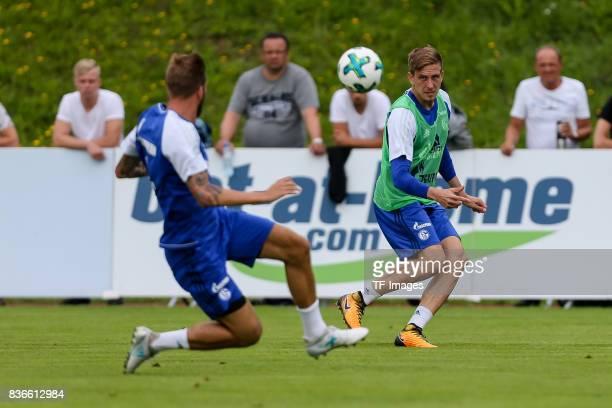 Guido Burgstaller of Schalke and Bastian Oczipka of Schalke battle for the ball during the Training Camp of FC Schalke 04 on July 30 2017 in...