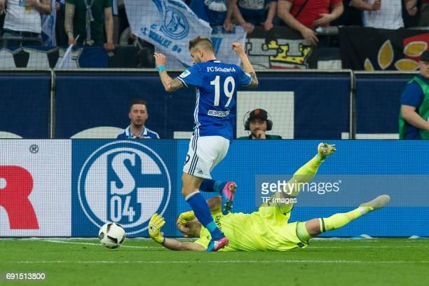 Guido Burgstaller of Schalke and Goalkeeper Christian Mathenia of Hamburg battle for the ball during to the Bundesliga match between FC Schalke 04...