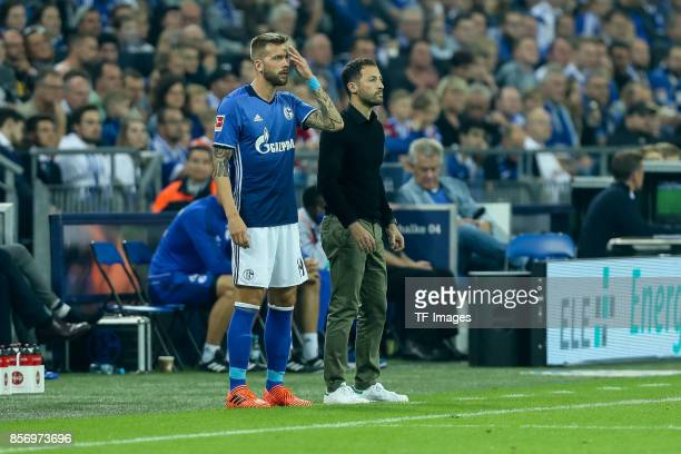 Guido Burgstaller of Schalke and Head coach Domenico Tedesco of Schalke looks on during the Bundesliga match between FC Schalke 04 and Bayer 04...