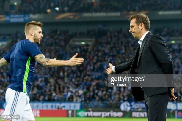 Guido Burgstaller of Schalke and Head coach Markus Weinzierl of Schalke gestures during the UEFA Europa League Round of 16 first leg match between FC...