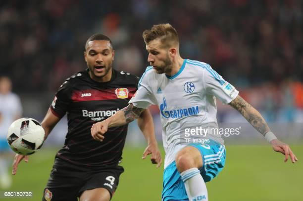 Guido Burgstaller of Schalke and Jonathan Tah of Leverkusen battle for the ball during to the Bundesliga match between Bayer 04 Leverkusen and FC...