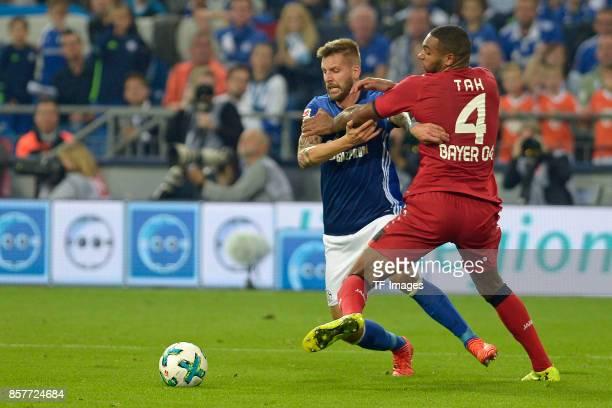 Guido Burgstaller of Schalke and Jonathan Tah of Leverkusen battle for the ball during the Bundesliga match between FC Schalke 04 and Bayer 04...