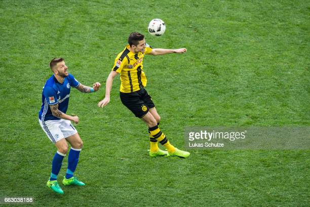 Guido Burgstaller of Schalke and Julian Weigl of Dortmund in action during the Bundesliga match between FC Schalke 04 and Borussia Dortmund at...