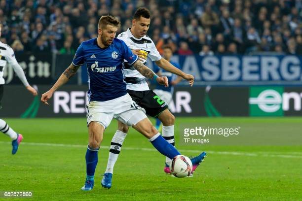 Guido Burgstaller of Schalke and Kolo Timothee Kolodziejczak of Borussia Moenchengladbach battle for the ball during the UEFA Europa League Round of...