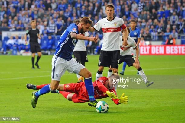 Guido Burgstaller of Schalke and RonRobert Zieler of Stuttgart and battle for the ball during the Bundesliga match between FC Schalke 04 and VfB...