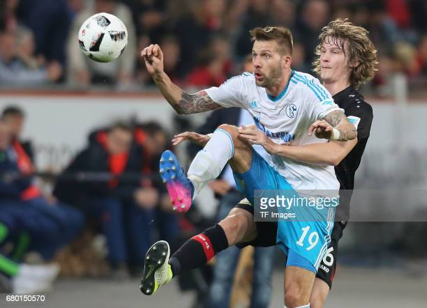 Guido Burgstaller of Schalke and Tin Jedvaj of Leverkusen battle for the ball during to the Bundesliga match between Bayer 04 Leverkusen and FC...