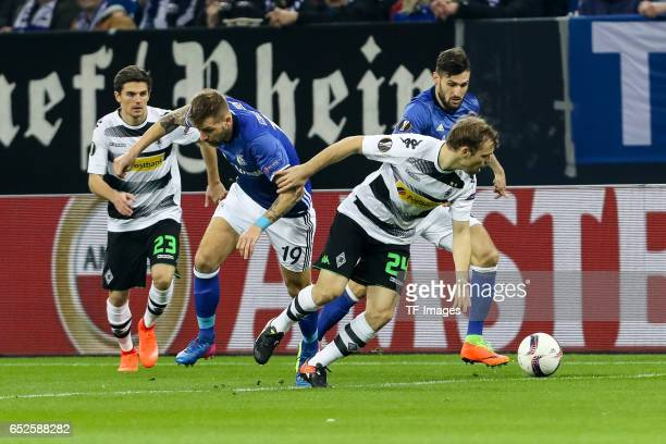 Guido Burgstaller of Schalke and Tony Jantschke of Borussia Moenchengladbach battle for the ball during the UEFA Europa League Round of 16 first leg...