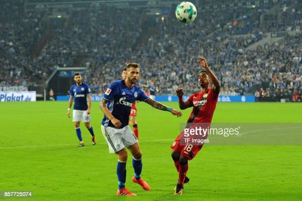 Guido Burgstaller of Schalke and Wendell of Leverkusen battle for the ball during the Bundesliga match between FC Schalke 04 and Bayer 04 Leverkusen...