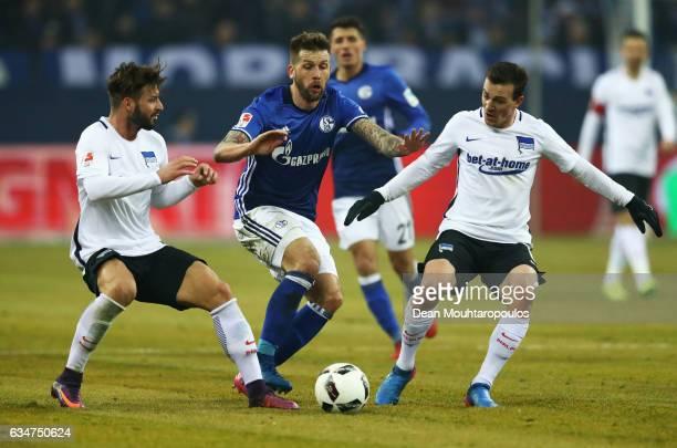 Guido Burgstaller of Schalke battles for the ball with Vladimir Darida and Marvin Plattenhardt of Hertha BSC during the Bundesliga match between FC...