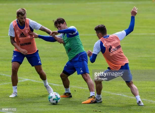 Guido Burgstaller of Schalke Benjamin Stambouli of Schalke Fabian Reese of Schalke battle for the ball during the Training Camp of FC Schalke 04 on...