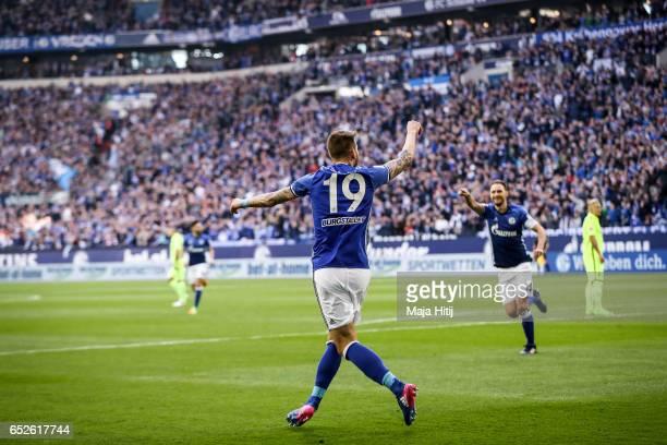 Guido Burgstaller of Schalke celebrates after scoring a goal to make it 10 during the Bundesliga match between FC Schalke 04 and FC Augsburg at...