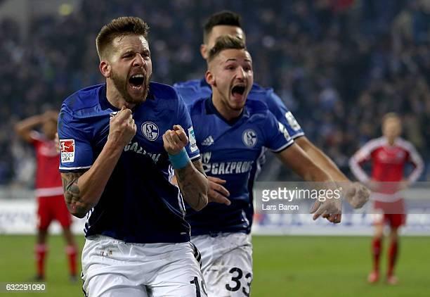 Guido Burgstaller of Schalke celebrates after scoring his teams winning goal during the Bundesliga match between FC Schalke 04 and FC Ingolstadt 04...