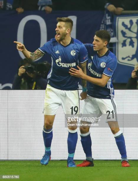 Guido Burgstaller of Schalke celebrates as he scores their first and equalising goal with Alessandro Schoepf during the UEFA Europa League Round of...