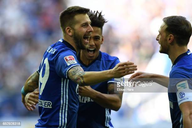 Guido Burgstaller of Schalke celebrates scoring his side's first goal with his team mates during the Bundesliga match between FC Schalke 04 and FC...