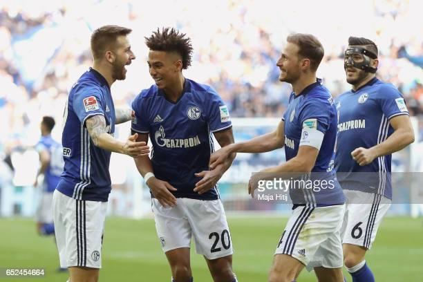 Guido Burgstaller of Schalke celebrates scoring the opening goal with his team mates Thilo Kehrer Benedikt Hoewedes and Sead Kolasinac during the...