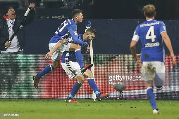 Guido Burgstaller of Schalke celebrates with Alessandro Schoepf after scoring a goal to make it 10 during the Bundesliga match between FC Schalke 04...