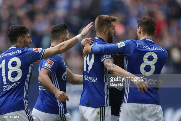 Guido Burgstaller of Schalke celebrates with his teammates after scoring a goal to make it 10 during the Bundesliga match between FC Schalke 04 and...