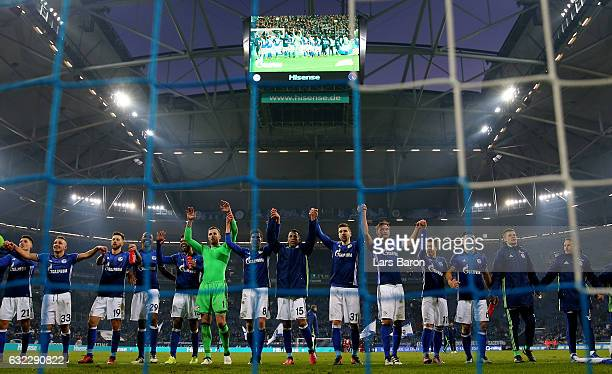 Guido Burgstaller of Schalke celebrates with team mates after winning the Bundesliga match between FC Schalke 04 and FC Ingolstadt 04 at VeltinsArena...