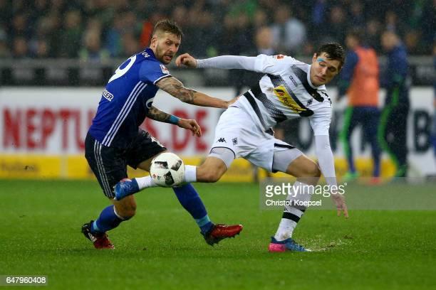 Guido Burgstaller of Schalke challenges Andreas Christensen of Moenchengladbach during the Bundesliga match between Borussia Moenchengladbach and FC...