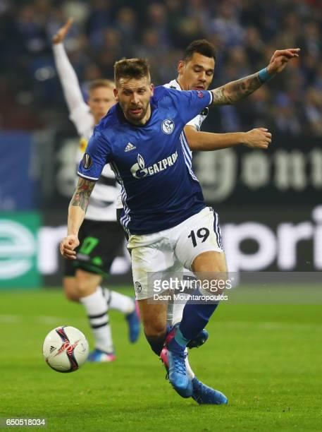 Guido Burgstaller of Schalke evades Timothee Kolodziejczak of Borussia Moenchengladbach during the UEFA Europa League Round of 16 first leg match...