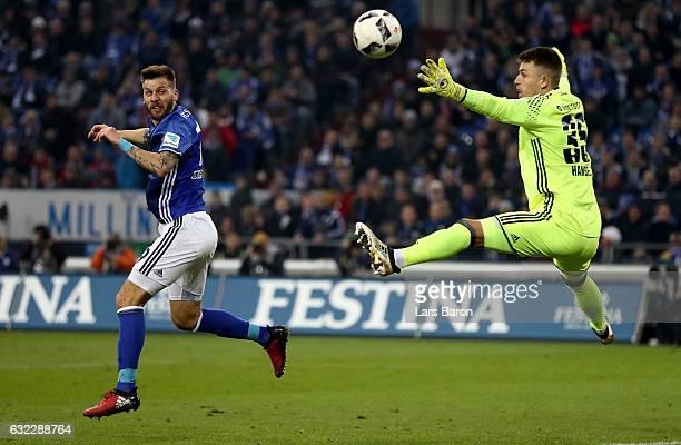 Guido Burgstaller of Schalke heads the ball next to Martin Hansen of Ingolstadt during the Bundesliga match between FC Schalke 04 and FC Ingolstadt...