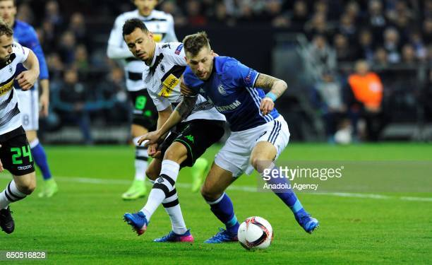 Guido Burgstaller of Schalke in action against Timothee Kolodziejczak of Moenchengladbach during the UEFA Europa League Round of 16 first leg...