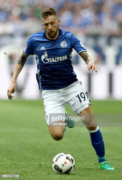 Guido Burgstaller of Schalke runs with the ball during the Bundesliga match between FC Schalke 04 and Borussia Dortmund at VeltinsArena on April 1...
