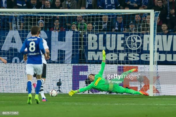 Guido Burgstaller of Schalke scores a goal Goalkeeper Yann Sommer of Borussia Moenchengladbach in action during the UEFA Europa League Round of 16...